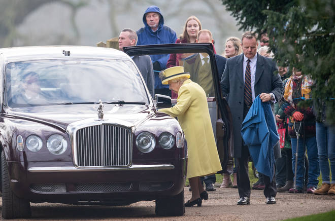The Queen steps into a vehicle after attending the morning service