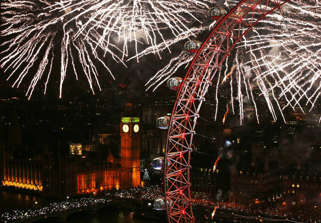 Fireworks light up the sky over Big Ben and the London Eye in central London during the New Year celebrations.
