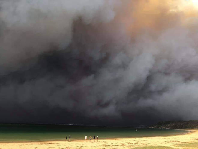 The town of Long Beach, Batemans Bay is across the water, obstructed by smoke
