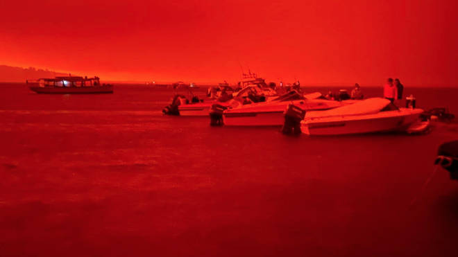 The sky was blood-red as the fire approached the coast