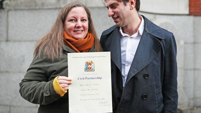 The happy couple after becoming one of the first couples to register for a civil partnership.