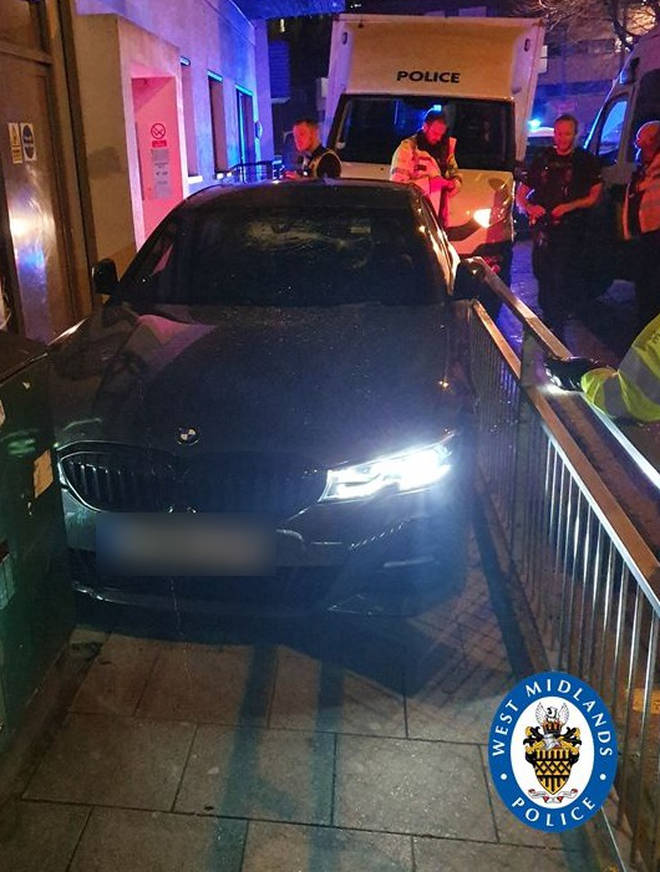 The car became trapped after speeding off