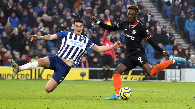 Chelsea's Tammy Abraham (right) and Brighton and Hove Albion's Lewis Dunk battle for the ball