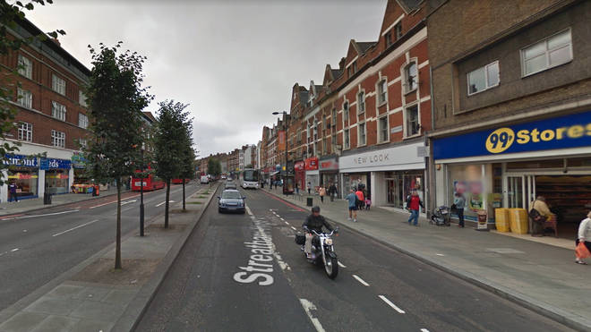 A man has been arrested for the unprovoked attack on a mother in front of her child