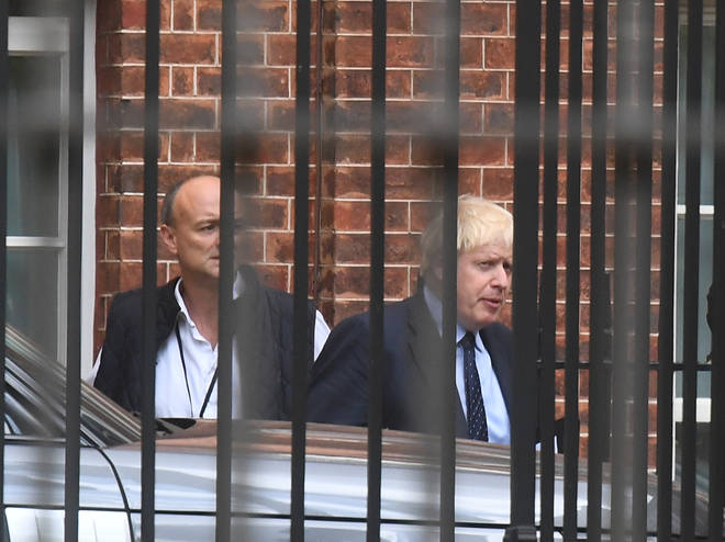 Prime Minister Boris Johnson with his senior aid Dominic Cummings as they leave Downing Street.