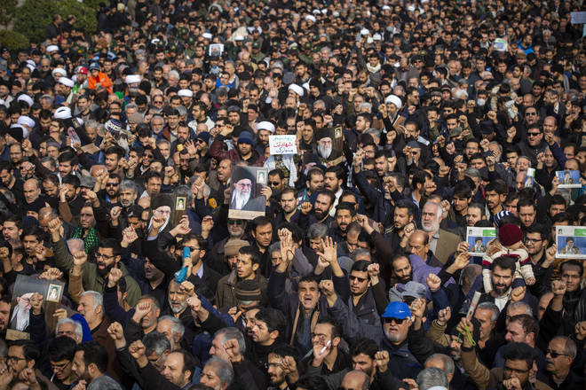 Thousands have taken to the streets in Iran to mourn the death of Soleimani