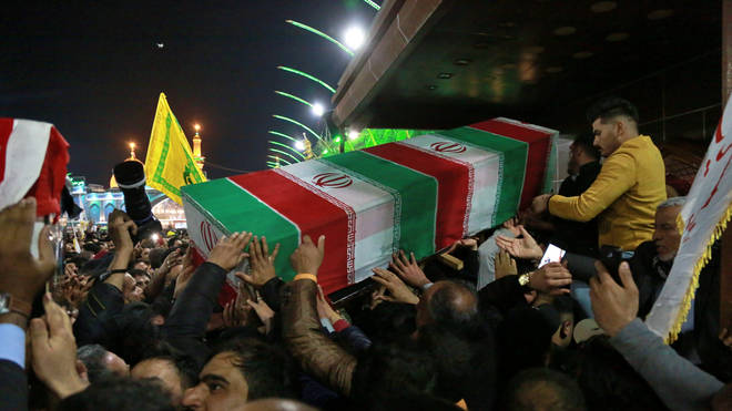 Mourners carry the coffin of Iran's top general Qassem Soleimani during his funeral in Karbala, Iraq,