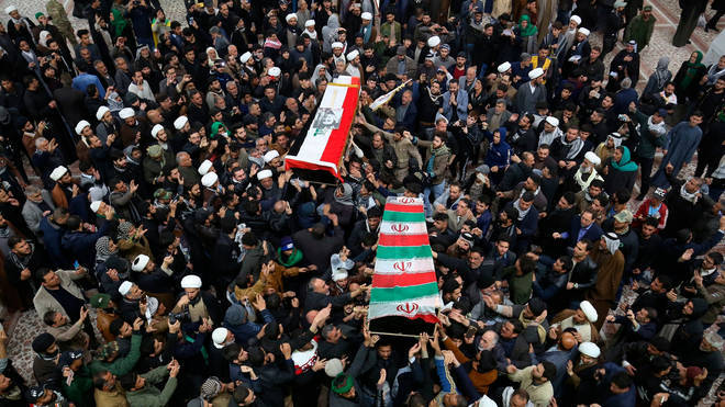 Mourners carry the coffins of Iran's Gen. Qassem Soleimani and Abu Mahdi al-Muhandis, deputy commander of Iran-backed militias