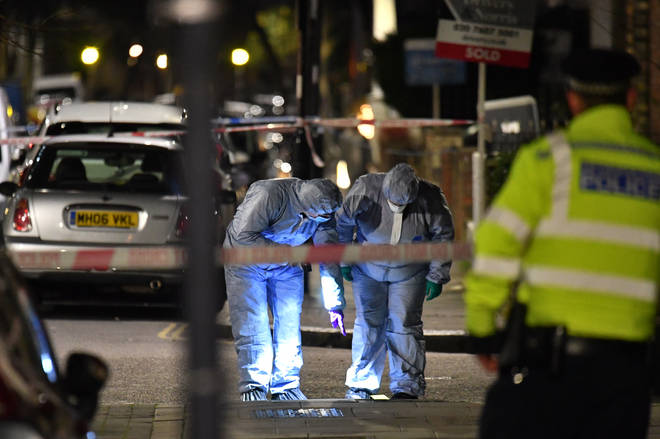 Forensics officers at the scene of the fatal stabbing