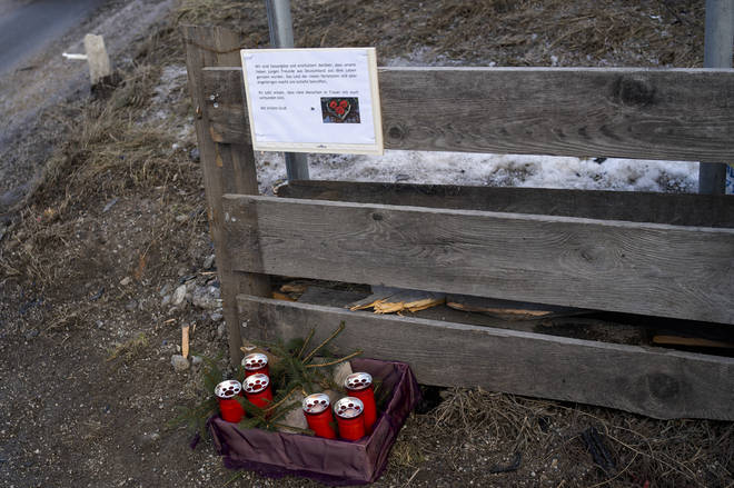 Candle and a commemoration letter placed at the at the scene where a car had plowed into a group of people in Luttach