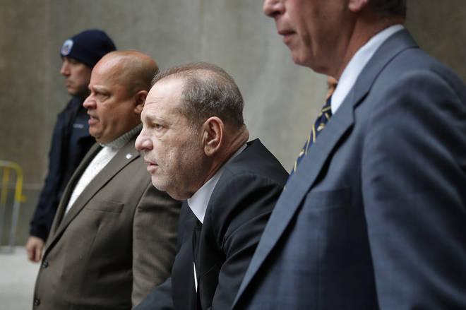 Harvey Weinstein, third from left, leaves court in New York