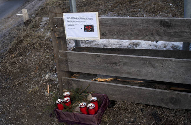 Candle and a commemoration letter placed at the at the scene where a car had plowed into a group of people in Luttach.