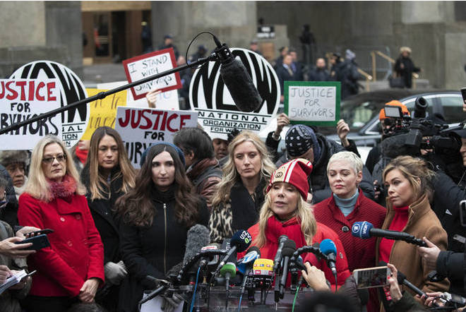 Actor Rose McGowan, right, speaks at a news conference as actor Rosanna Arquette, center left, listens outside a Manhattan courthouse after the arrival of Harvey Weinstein.