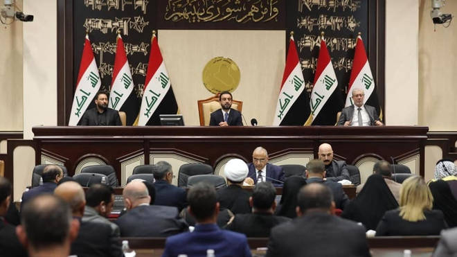 Iraqi parliament speaker Mohamed al-Halbosi (C-up) and Iraqi Prime Minister Adel Abdul-Mahdi (C-down) attend a session of the Council of Representatives of Iraq