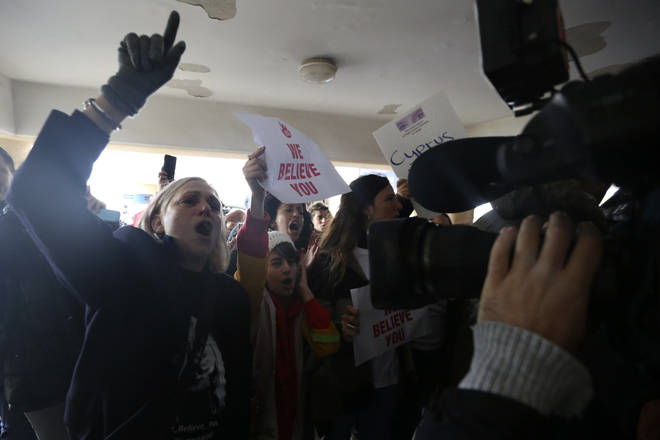 Protesters shout slogans outside a court before the arrival of a 19 year-old British woman that was found guilty of making up claims she was raped by up to 12 Israelis.