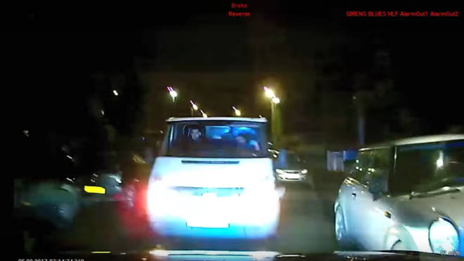 The moment the van rammed the police car injuring two officers
