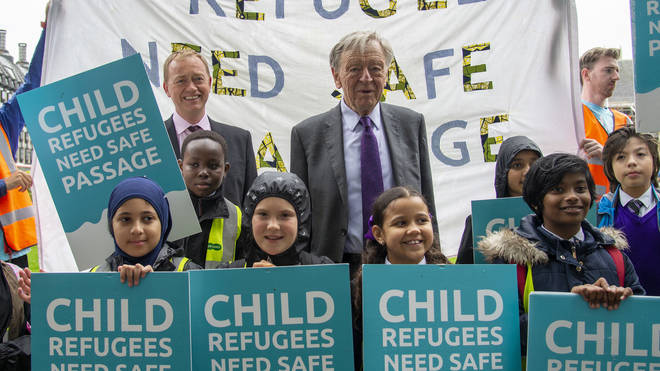 Lord Alf Dubs with children as campaigners from Safe Passage UK and Lord Alf Dubs Children Fund