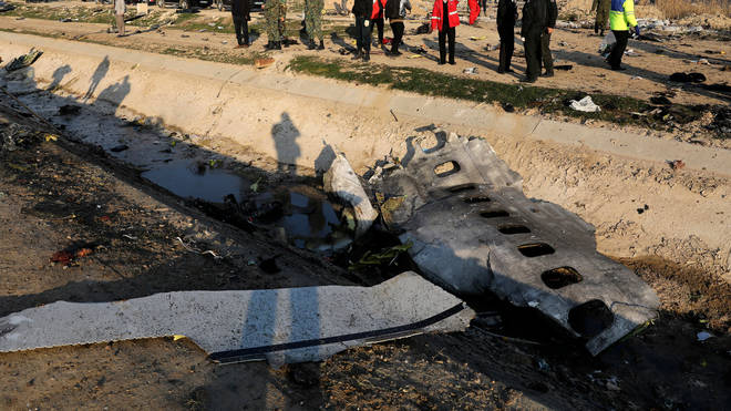 Investigators examine the wreckage of the downed plane