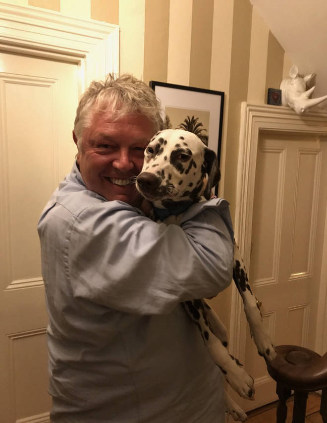 Nick Ferrari hugs a Croatian following the World Cup defeat