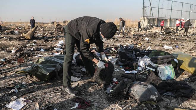 Rescuers are examining the debris