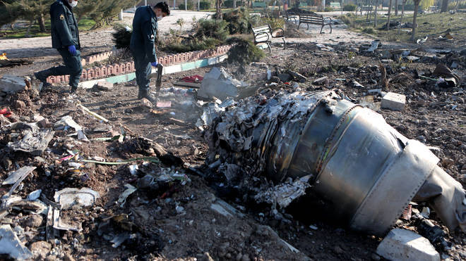 Investigators are examining the wreckage of the downed plane