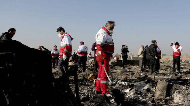 Rescue workers at the site of the crash