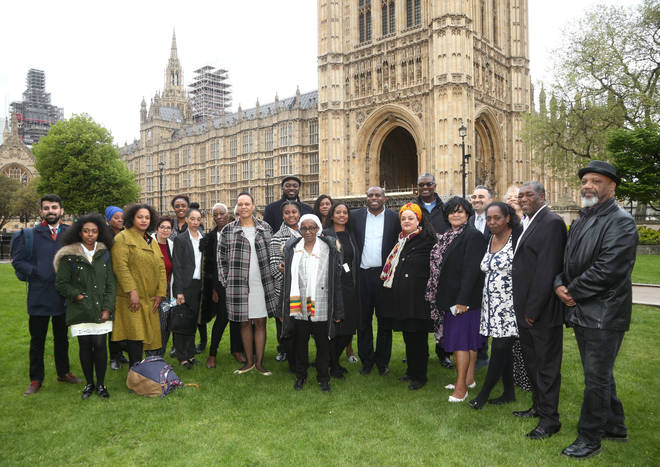David Lammy MP (centre) with members of the Windrush generation following a personal apology from immigration minister Caroline Nokes, as they visited Parliament for the first time since the scandal forced the home secretary to resign.