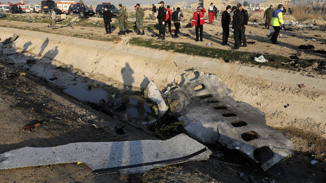 Investigators examine wreckage after the plane crashed