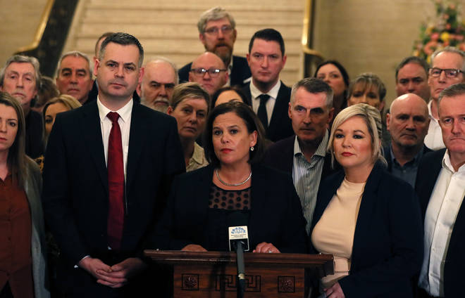 Sinn Fein leader Mary Lou McDonald (centre), deputy leader Michelle O'Neill (centre right) and party colleagues speak to the media in the Great Hall of Parliament Buildings
