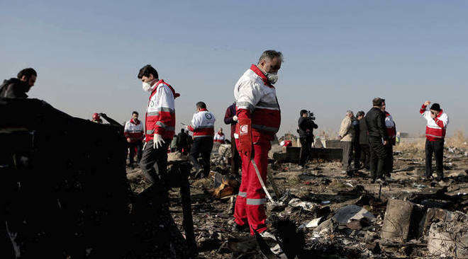 Rescue workers at the scene of the plane crash