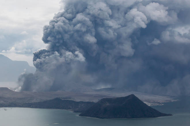 The Taal Volcano erupts with a massive plume of ash and steam in Batangas Province, the Philippines,