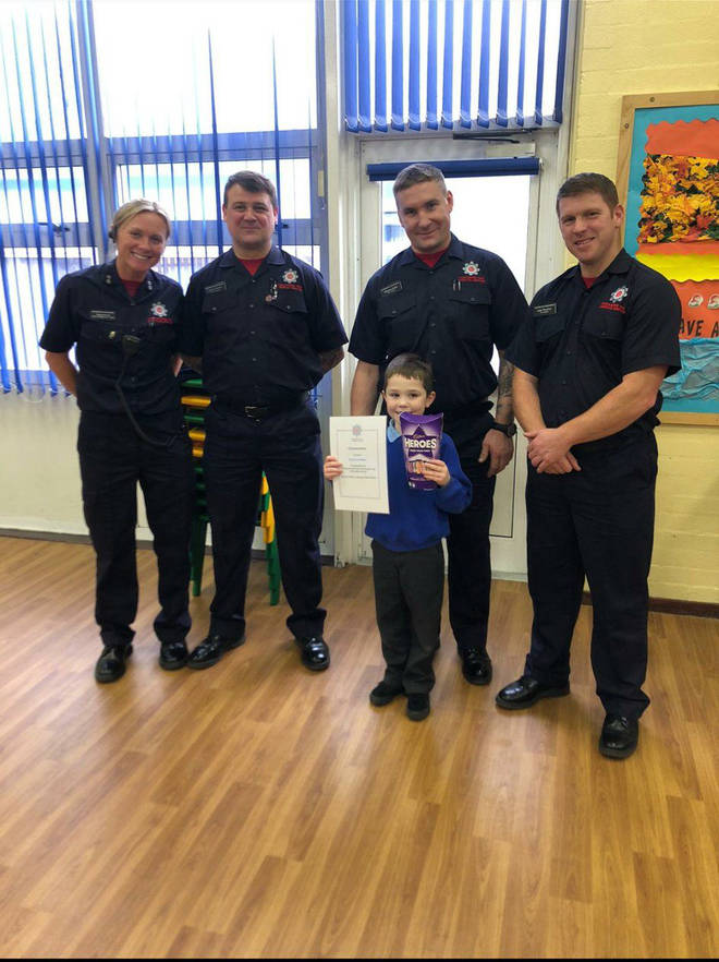 Firefighters presented him with a box of Heroes