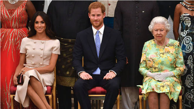 Meghan Markle, Prince Harry and the Queen pictured together in 2018 at the Queen's Young Leaders Awards Ceremony at Buckingham Palace, London.