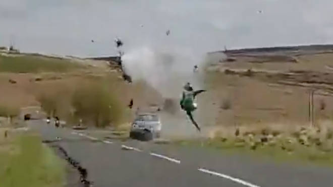 The biker flies through the air before hitting the ground