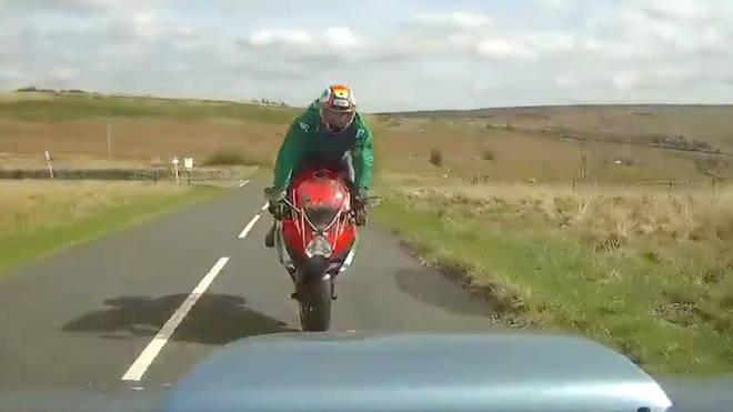 Footage from the car which hit the biker shows the moment before the impact