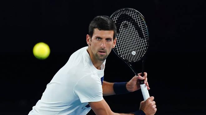 Novak Djokovic plays a shot during a practice session