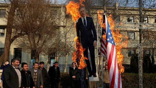 An effigy of the ambassador was burned as part of a demonstration