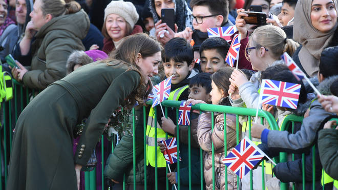 Kate greets some of the youngest in the assembled crowd