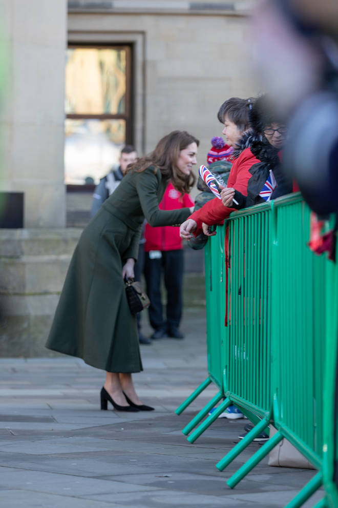 Kate opted for a long, military style khaki coat by British designer Alexander McQueen.