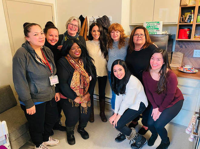 Meghan was pictured at a women's shelter in Canada