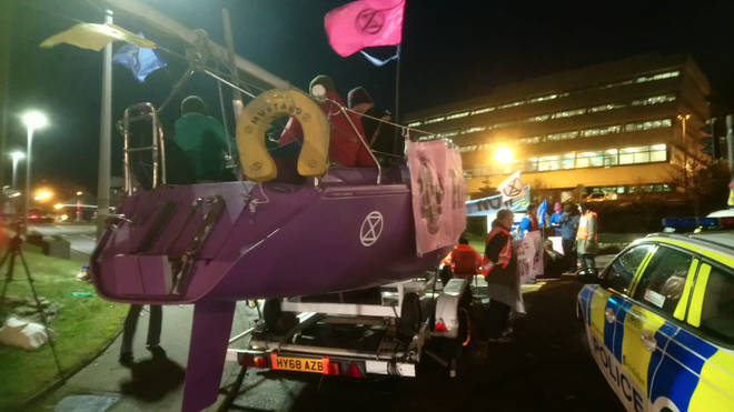The protestors are using a huge purple boat