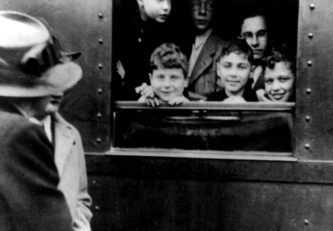 Children in Germany saying goodbye to their families on the Kindertransport train