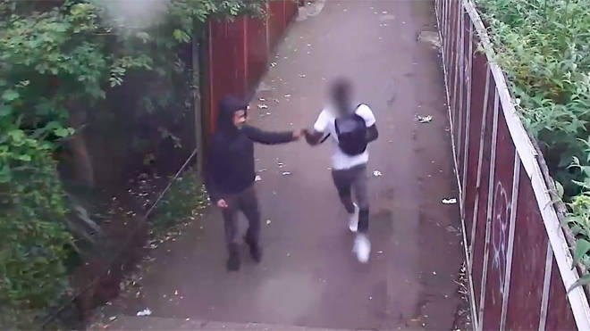 The teenagers fist-bump each other shortly after stabbing a man to death