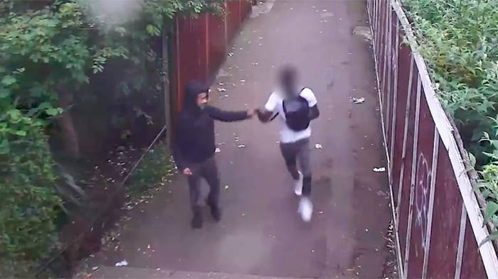 Moment killers 'fist bump' in alley after stabbing 18-year-old to death
