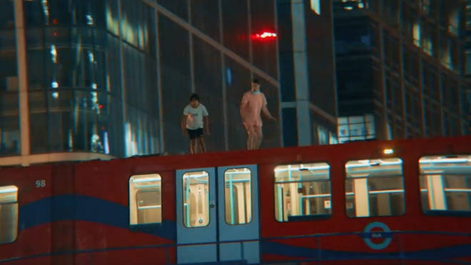 YouTubers condemned for leaping from moving DLR train.