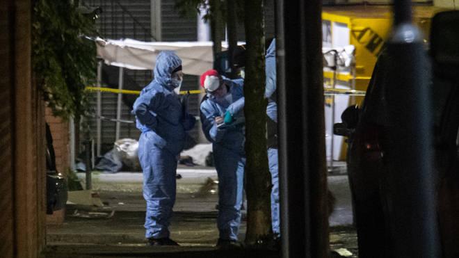Police investigators at the scene in Ilford, east London