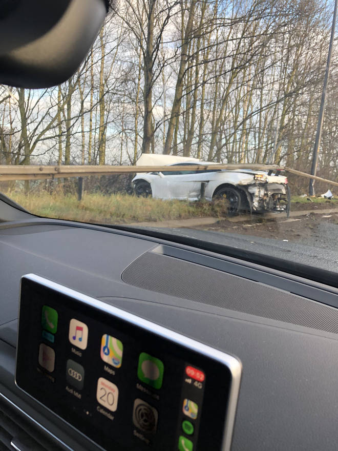 The sports car can be seen wedged under a crash barrier