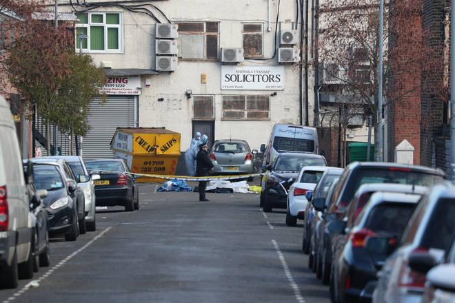 Police at the scene in Ilford