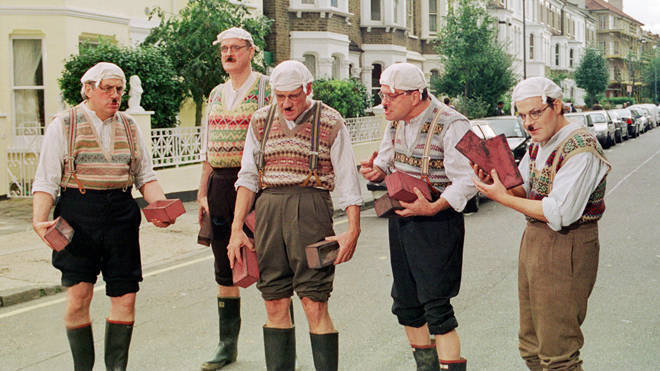 Terry Jones, John Cleese, Michael Palin, Terry Gilliam and Eddie Izzard dressed as Gumbies for a sketch for 'Python Night' in 1999