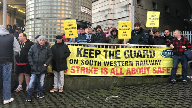 RMT members protest outside Waterloo station
